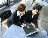 Two students working Smartly on a computer