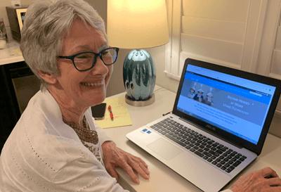 Kathy sitting at a computer