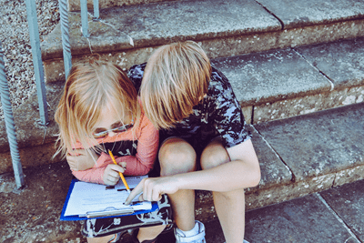 two little kids studying together